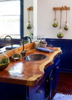 Gorgeous natural edge wood countertop in this bathroom