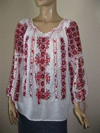 Incredible intricate and beautiful detailed Romanian peasant blouse .