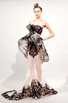 I like this--weird and striking at the same time :) Marchesa Spring 2011