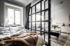 Small bedroom with glass wall