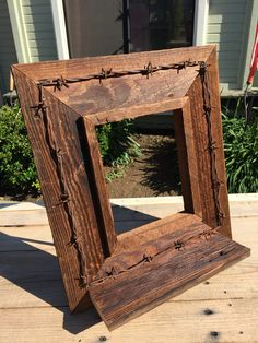 Picture frame/Shelf made from Reclaimed Barn Wood & Barbed Wire.