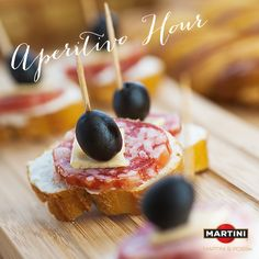 Make easy to serve Italian-inspired appetizers with a crusty baguette, hard salami, gouda, and olives.