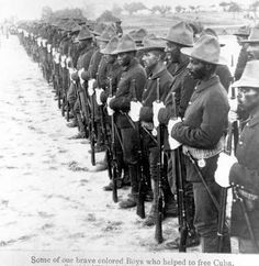 """Contemporary picture of American Army Buffalo Soldiers during the Spanish-American War. The text reads """"Some of our brave colored Boys who helped to free Cuba"""""""