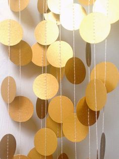 Lovely long and luscious 1 inch circle paper garland strand in a stunning shimmery gold ( or choose your colour from gold, silver or pearlescent
