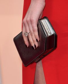 Pin for Later: See the Best Fall Nail Trends From the American Music Awards Red Carpet Dakota Johnson, Oscars Dakota wore a short, vampy manicure (and a huge diamond!) to the Oscars.
