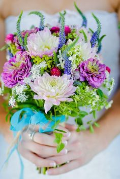 We love the vibrancy in this wedding bouquet- perfect for a spring wedding. Taken by Browns Photography.