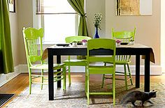 I love these mismatched dining chairs. They look great painted all the same color green.