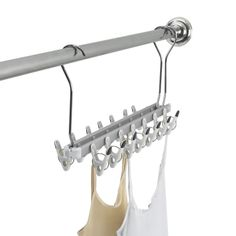 For space-efficient drying of delicate items, or even heavier items like jeans, try the OXO Good Grips Folding Clip Dryer. Three hooks hang securely on a shower curtain rod while in use - even curved or corner rods. 14 non-slip clips keep clothes hanging on. $21.99