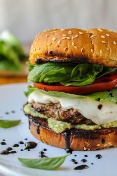 Caprese Burger with Artichoke Pesto Sauce  This caprese-salad-style burger is packed with fresh mozzarella, basil, and tomato. A balsamic glaze and pesto sauce kick things up. It's like an awesome mashup of 2 iconic summer meals.
