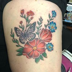 8acec2abc Pretty floral piece completed by Pineapple at #LuckyBambooTattoo. #flower  #butterfly #color