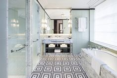 A bathroom at The Beaumont Hotel London with architectural details, and geometric prints