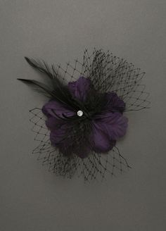 In BLACK - Flower Clip with Tulle & Feather Spray - Style 8015. $14.00   On trend & great for spicing up any outfit.  Click on the color selection button to see it in BLACK: www.davidsbridal.com/Product_Flower-Clip-with-Tulle-and-Feather-Sprays-8015