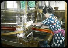 A girl weaving silk in an old fashioned loom (home made)  Enami Studio Lantern Slide No : 644.  About 1920's, Japan