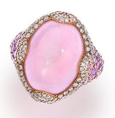 A pink opal, diamond and pink sapphire ring, Asprey centering a cabochon pink opal, measuring approximately 19.80 x 14.50 x 10.20mm., surrounded by round brilliant-cut diamonds, further accentuated by oval and circular-cut pink sapphires; signed Asprey.