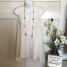 •Cream Flowy Sleeveless Top• This very cute and pretty cream top is a great addition to your spring/summer wardrobe• Mesh embroidered design on the front shoulder and back area• Hi-lo type• Material description (pic 4) No Trade/Pp LC Lauren Conrad Tops Tunics