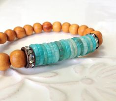 Love the shape & color of these new aquamarine beads! Sandalwood w Stacked Aquamarine Heishi Disc Beaded by LoveandLulu