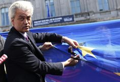 Dutch far-right Freedom Party (PVV) leader Geert Wilders cuts a star from the European Union flag during a demonstration in front of the EU Parliament in Brussels May 20, 2014. It was meant to be the campaign launch of a new Eurosceptic alliance, but the planned April 16 meeting starring France's Marine Le Pen and Dutchman Geert Wilders in Strasbourg, home of the European Parliament, never took place.