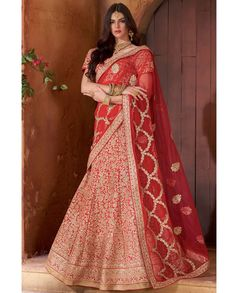 Red lehenga with heavy zari resham floral embroidery all over   1. Red banarasi raw silk Santoon heavy embroidered lehenga2. Zari resham and stone floral embroidery  , zari and resham embroidered blouse with floral motif on dupatta3. Can be stitched upto size 40 inches , lehenga waist 40 and lehenga length 44 inches4. 0.80 mtr Choli : 2.25 mtr Dupatta : 3 mtr Lehenga