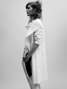 Black & white contrast. Oversize coat and sport luxe pants. Effortlessly stylish.