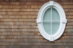 """Find """"oval window"""" stock images in HD and millions of other royalty-free stock photos, illustrations and vectors in the Shutterstock collection. Thousands of new, high-quality pictures added every day. Shingle Siding, Windows And Doors, House Siding, Shingle Exterior, Windows Exterior, Window Design, Oval Window, Hamptons House, Octagon Window"""