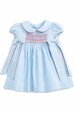 Free shipping and returns on Luli & Me Viyella Smocked Dress (Baby Girls) at Nordstrom.com. She'll be ready for holiday parties in this darling dress featuring floral embroidery at the smocked panel and pretty contrast ruffles along the neck and sleeves.