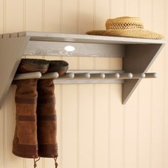 Wellington Shelf Our wall mounted boot rack elevates wellingtons beyond the reach of creepy-crawlies or mice and keeps the cloakroom floor clear and free of mud. Sized to suspend four pairs of boots, it also provides a substantial shelf for keys, dog leads, hats and other hallway clutter. Crafted from FSC wood from managed forests with a French grey painted finish, it is provided with apertures in the back for wall hanging plus nine wooden pegs and all fixings separately for simple assembly.