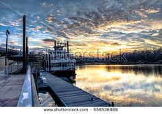 Montgomery, Alabama, USA - January 16, 2017: The riverboat attraction, Harriett II, docked at Riverfront Park in downtown Montgomery with a nice sunset over the Alabama River.