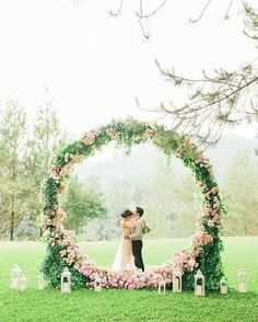 Extra large grapevine wreath decorated with flowers and greenery. The perfect back drop to a rustic wedding no matter what season!