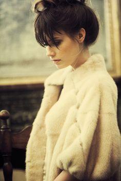 bun, bangs, & that coat