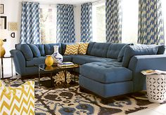 I love the sofa and Love those curtains! Cindy Crawford Metropolis Indigo 4Pc Sectional Living Room at Rooms To Go