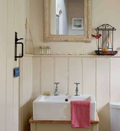 A restored farmhouse in the Welsh countryside | Period Living  Bathroom. Like sink, pretty mirror and panels