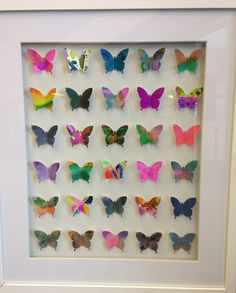 Kids started with square of watercolor paper, watercolored and then stamped out a butterfly. Affix to paper and mount in shadowbox frame.