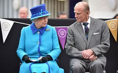 The Queen talks to her husband, the Duke of Edinburgh,  at Tweedbank Station