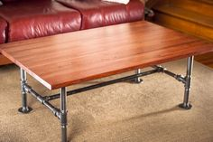 Coffee table built using repurposed oak butcher block. Base built using galvanized steel pipe.