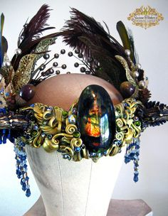 WOODLAND GODDESS - Deer Antler Headdress Fairy Princess Crown Costume Pagan Priestess by Susan Tooker of Spinning Castle. The WOODLAND GODDESS Faerie Princess Antler Crown is covered in crystals and gold leaf. It displays a centerpiece stone that is a beautiful, flashing Spectrolite surrounded by sculpted leaves, spirals and acorns.