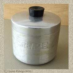 We had one of these on the back of the stove when I was growing up for the bacon grease.