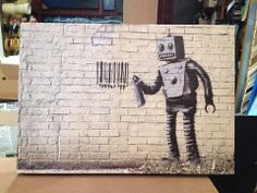 "Barcode Robot - We are very excited to announce that we just received BANKSY canvas prints!!! The man of mystery's famous spray art! So very awesome!! Come in to our Gastown location to check them out and pick one up, or 2 or 3 :) Each one is 20"" x 30"". At the moment we only have one of each in stock. They will be going fast! www.kimprints.com"
