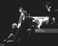 Rock and roll band 'The Rolling Stones' performs onstage on a TV show leaning against a Rolls Royce in 1965. (L-R) Brian Jones, Charlie Watts, Mick Jagger, Keith Richards, Bill Wyman.