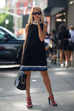 Natalie Joos in black shift dress with colorful neckline & hem #NYFW | Street Style New York #Fashion Week Spring 2014 #spring2014