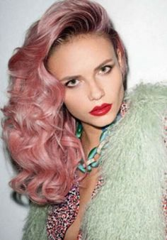 Messy side swept style with pink colouring