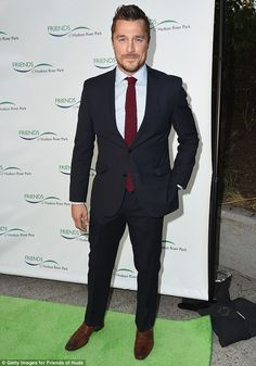 Suited up: Chris Soules looked dapper in a black suit, light greyish blue blouse and burgundy tie