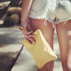 🌞suns out buns out 🌞 . ➳ mellow yellow clutch available soon ➳ saltandsol.us . . . #sunsoutbunsout #handmade #beachvibes #mellowyellow #leatherbags #bohochic #californiastyle #goodvibesonly