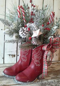 ★★★ RESERVED for Pamala★★★    ★★SALE - 25% off THIS item when you use coupon code HOLIDAYSALE at checkout★★    Cowboy Boot Arrangement    Howdy Ya All!    These addorable Red Cowboy boots make for the Sweetest Holiday arrangement!    Filled with life like holiday snowy pine and red berries, 2 candy canes, pine cones and white glittered stars. Finished with 2 white bells and a country checked bow. Heel and trim of boots are covered with white paint and white glitter    Approximately 16 tall…