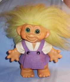 Trolls were popular in the early 60's and they came in every size and hair color.  My friends and I used to make clothes and furniture for them.  Good times.