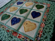 Hey, I found this really awesome Etsy listing at http://www.etsy.com/listing/113275328/country-hearts-wall-hanging-quilt-green