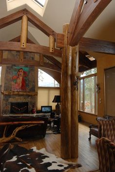 Post and beam/log work - eclectic - family room - denver - Great Divide Builders