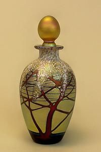 Glittering opalescent collectable blown glass perfume bottle. Gold Cherry Blossom Perfume Bottle by Carl Radke: Art Glass Perfume Bottle available at www.artfulhome.com