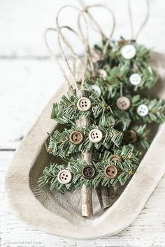 Make this Rustic Holiday Ornament in less than 10 minutes! Kelly of Live Laugh Rowe created this simple, rustic Holiday Ornament using a stick, faux pine stem and buttons. This wooden tree would also. Rustic Christmas Ornaments, Homemade Christmas Decorations, Handmade Christmas, Christmas Fun, Ornaments Ideas, Christmas Design, Ornaments Design, Elegant Christmas, Rustic Homemade Christmas Ornaments