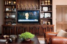 A custom-made television cabinet displays Sorkin's numerous awards, a haul that includes six Emmys and an Oscar.