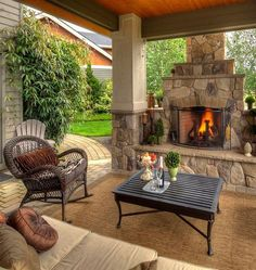 Chic wicker rocking chair in Patio Traditional with Small Outdoor Fireplace next to Fireplace Screen alongside Covered Patios With Fireplaces and Patio Fireplace Outside Living, Outdoor Living Areas, Outdoor Rooms, Outdoor Decor, Living Spaces, Outdoor Photos, Outdoor Kitchens, Outdoor Seating, Outdoor Retreat